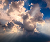 Rays of light shining through dark clouds — Stock Photo