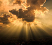 Rays of light shining through dark clouds — Stock Photo