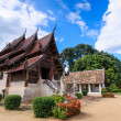 Stock Photo: Old wooden church of Wat Tonkain