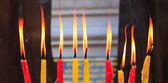 Lighting prayer candle — Stock Photo