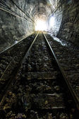 Light at the end of railroad tunnel — Stock Photo