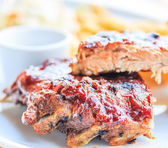 Grilled pork ribs. With tomato sauce — Stok fotoğraf