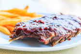 Grilled pork ribs. With tomato sauce — Stock Photo