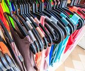 Clothes hang on a shelf — Stock Photo
