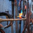 Welding copper pipes — Stock Photo