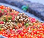 Fruits and tomato and longan vegetables — Stock Photo