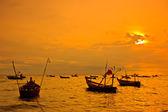 Thai boats at sunset beach — Stock Photo