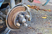 Disc brake and caliper on car — Stock Photo