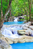 Waterfall and blue stream in the forest — Stock Photo