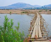 Bamboo bridge across the river — Stock Photo