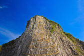 Carved buddha image on the cliff — Stock Photo