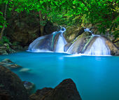 Waterfall and blue stream — Foto Stock