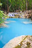 Waterfall and blue stream in the forest — 图库照片