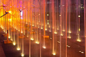 Colored water fountain at night — ストック写真