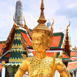 Golden statue of a Kinnara — Stock Photo