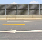 Noise barrier fence on the highway — Foto Stock