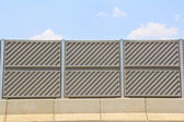 Noise barrier fence on the highway — Stock Photo