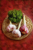 Pink garlic on a plate — Stock Photo