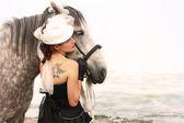 Girl dressed as Amazons and horseback — Stock Photo