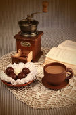 Cup of coffee with chocolate and coffee grinder — Stock Photo