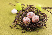 Easter composition with eggs and candles — Stock Photo