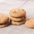 Stacked chocolate chip cookies on brown napkin. — Stock Photo