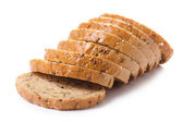 Healthy whole grain sliced bread with sunflower seeds on white b — Stock Photo