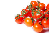 Juicy organic Cherry tomatoes isolated over white background — Stock Photo