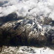 Aerial view on mountains from an airplane — Stock Photo