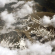 Aerial view on mountains from an airplane window — Stock Photo