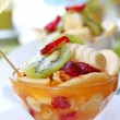 Fruit salad with kiwi, strawberries, bananas, other fruits and y — Stock Photo