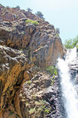 Beautiful waterfall in mountains — Stock Photo
