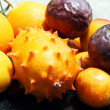 Stock Photo: Exotic fruits: orange, kiwano, loquat, peach and passionfruit