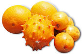 Exotic fruits: orange, kiwano and loquat - isolated on white bac — Stock Photo