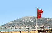The beautiful beach in Agadir with flag of Morocco — Stock Photo