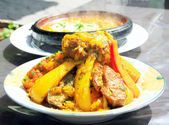 Two tajines (moroccan national dishes) of meet with eggs and veg — Stock Photo