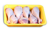 Chicken meat: legs in the retail tray — Stock Photo