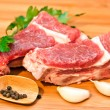 Raw beef with spices and vegetables on the cutting board — Stock Photo #20793041
