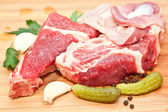 Raw beef with spices and vegetables on the cutting board — Stock Photo