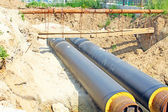 Tubes of pipeline in the ground — Stock Photo