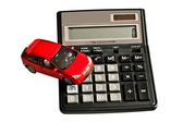 Toy car and calculator. Concept for buying, renting, insurance, — Stock Photo