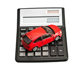 Toy car and calculator. Concept for buying, renting, insurance — Stock Photo