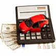 Toy car, money and calculator over white. Concept for buying, re — Stock Photo #23231736