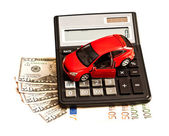 Toy car, money and calculator over white. Concept for buying, re — Stockfoto