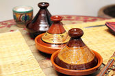 Different ceramic tajines with food on the table — Stock Photo