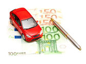 Toy car, pen and money over white. Rent, buy or insurance car co — Stock Photo