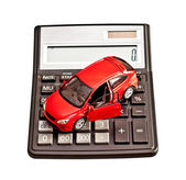 Toy car and calculator over white. Concept for buying, renting, — Foto de Stock