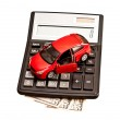 Toy car and calculator over white. Concept for buying, renting, — Stock Photo