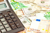 Business picture with money (dollar and euro) and calculator — Stock Photo