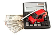 Toy car, money and calculator over white. Concept for buying, re — Stock Photo
